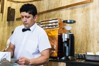 A male barista Inside the Florida Garden cafe, Buenos Aires.