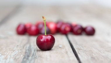 Cherries on a wooden table.