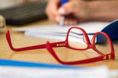 An eyeglasses on a desk.