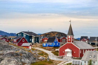 The Cathedral of Our Saviour Annaassisitta Oqaluffia and colorful houses in Nuuk.