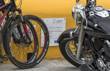 Bicycles and motorcycles at parking in Portuguese countryside