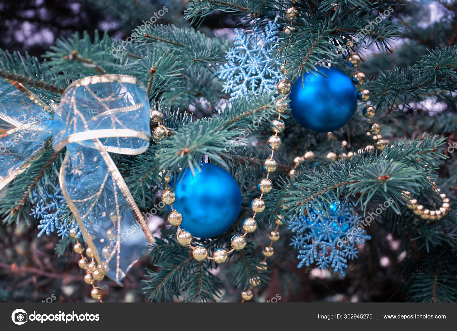Close Up Of A Christmas Tree With Rose Gold And Turquoise Decorations Balls Snowflakes Bows Beads On A Blurry Background With Snow Christmas And New Year Holidays Background Stock Photo Image By C