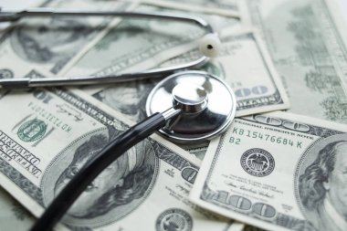 Stethoscope on the dollars. Medical costs.