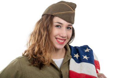 pretty young woman in ww2 uniform us with american flag