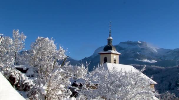 french small church in the snowy landscape