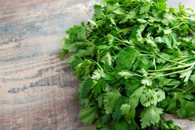Organic parsley closeup on rustic wooden table