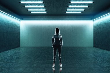 Hacker standing in futuristic green hall with blank wall and neon paints. Futuristic and presentation.