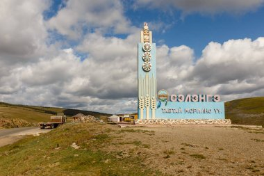 Bayangol, Mongolia - September 11, 2018: Information sign Welcome to Selenge Province on a highway in the Mongolian steppe. A sign designating the beginning of the Selenge Province.