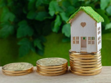 houses with stacks of coins