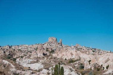 Ortahisar, Cappadocia / Turkey - June 2019: Panoramic cityscape photo of Ortahisar and Ortahisar Castle