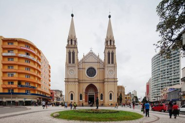 CURITIBA, PARANA/BRAZIL- Dec 23th, 2017: People at Tiradente's Square. This is a historical landmark of Parana in Brazil with Curitiba's Old Metropolitan Cathedral
