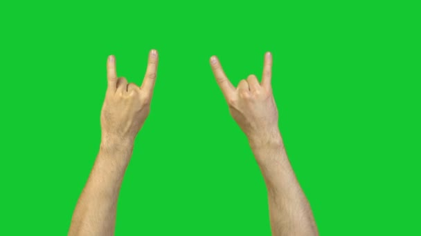 Male goat gesture on green background