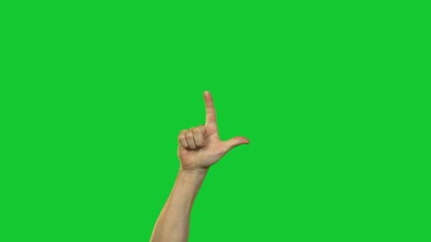 Ruce v počítání do deseti na zeleném pozadí