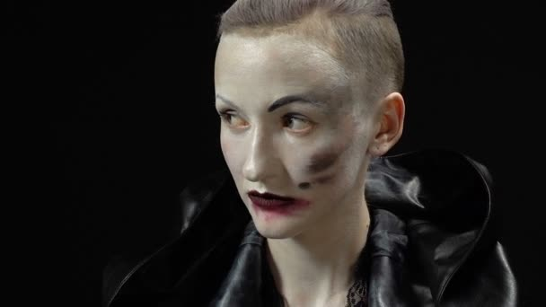 Footage of woman in black leather coat on black background