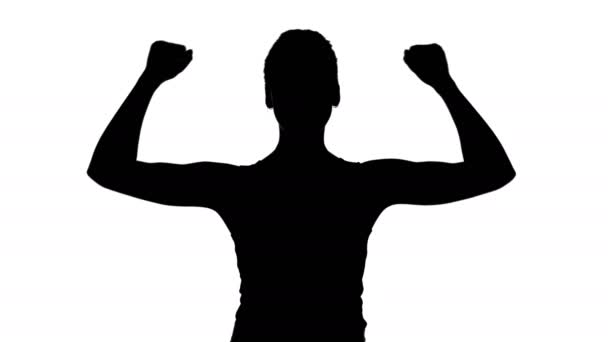Womans silhouette with hands up on white background