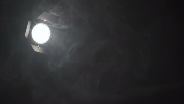 Video of spotlight in smoke on black background