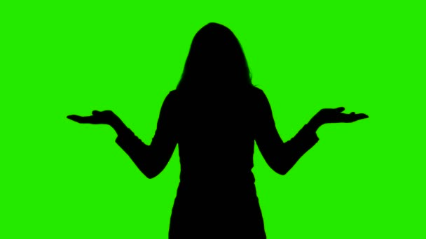 Video of shrugging womans silhouette on chroma key