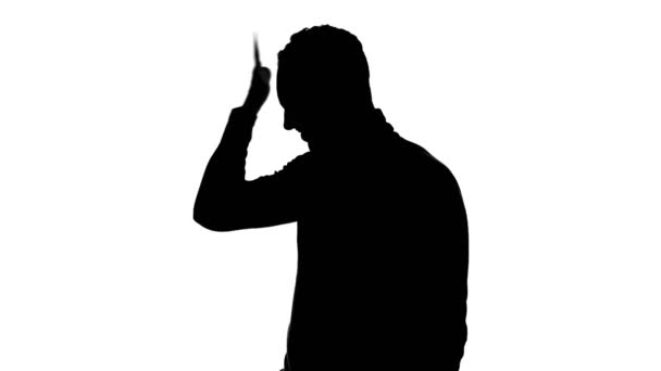Mans silhouette showing facepalm gesture