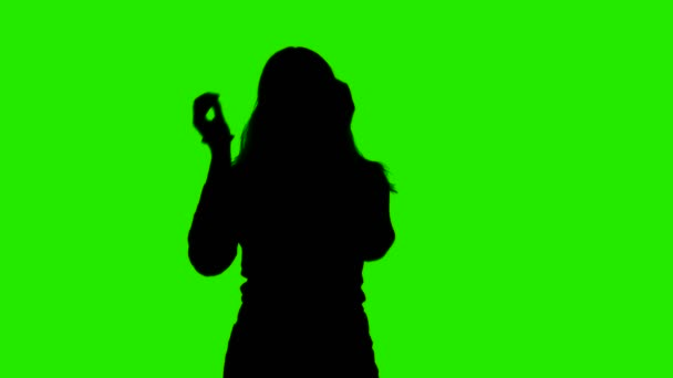 Video of womans silhouette making hair tail on chroma key