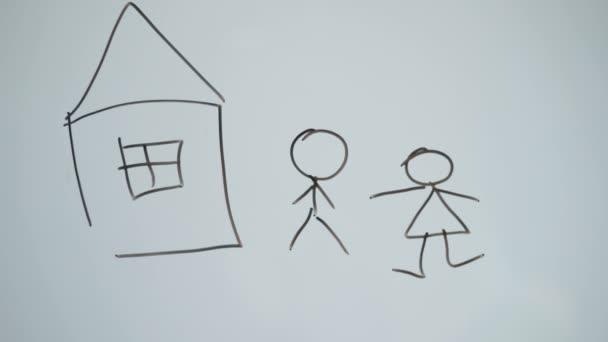 Zastřelení člověka kreslí rodinu a dům