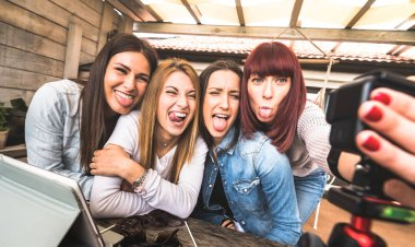 Young millennial women taking selfie for streaming platform through digital action web cam - Influencer marketing concept with millenial girls having fun vlogging live feeds on social media networks
