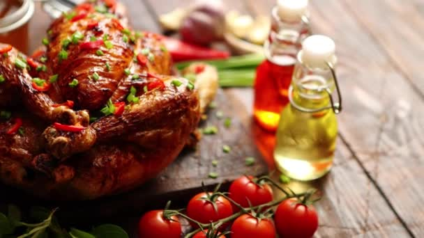 roasted whole chicken or turkey served on wooden chopping board with chilli pepers and chive with ingredients