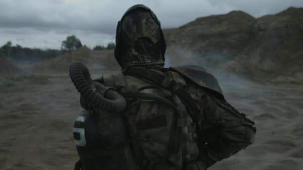 lonely armed warrior in chemical protection wandering through wasteland, Apocalypse concept