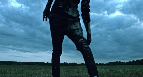 Scary zombie man walking outdoors