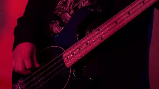 playing bass guitar, musical group
