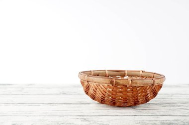 wicker basket on wooden background