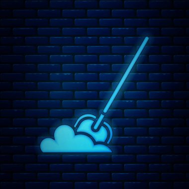 Glowing neon Shovel in the ground icon isolated on brick wall background. Gardening tool. Tool for horticulture, agriculture, farming. Vector Illustration