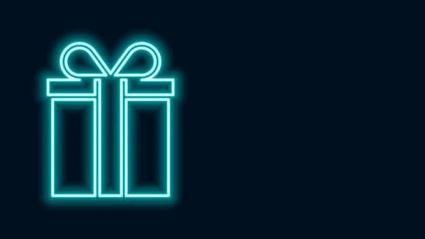 Ragyogó neon vonal Ajándék doboz ikon elszigetelt fekete háttér. 4K Videó mozgás grafikus animáció