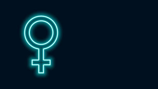 Ragyogó neon vonal Női nemi szimbólum ikon elszigetelt fekete háttér. Vénusz szimbólum. A női szervezet vagy nő szimbóluma. 4K Videó mozgás grafikus animáció