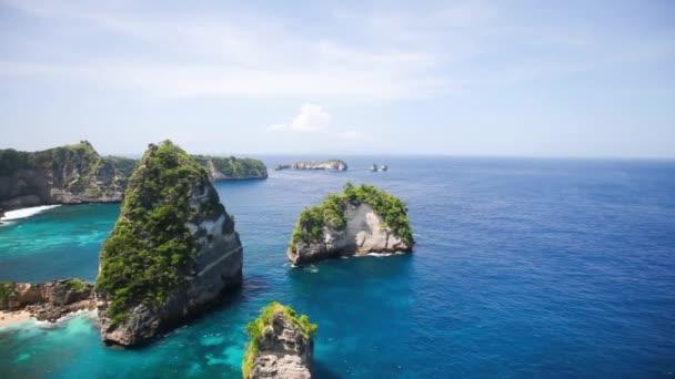 Aerial view of the small island of Nusa Batumategan and Nusa Batupadasan Island from the Atuh Rija Lima shrine on Nusa Penida Island near Bali, Indonesia.