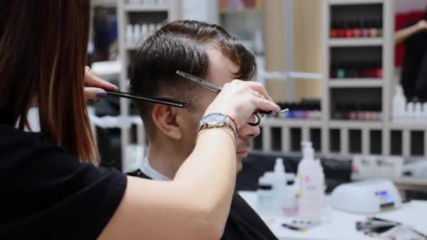 Man Hair Cut By Hands Of Professional Woman Hairdresser In Barbershop
