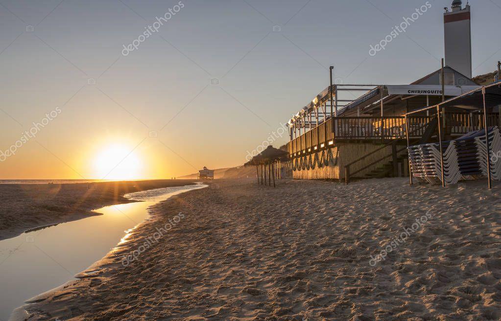 Chiringuito or beach bar at Costa de la Luz seashore, Matalascanas, Huelva. Sunset