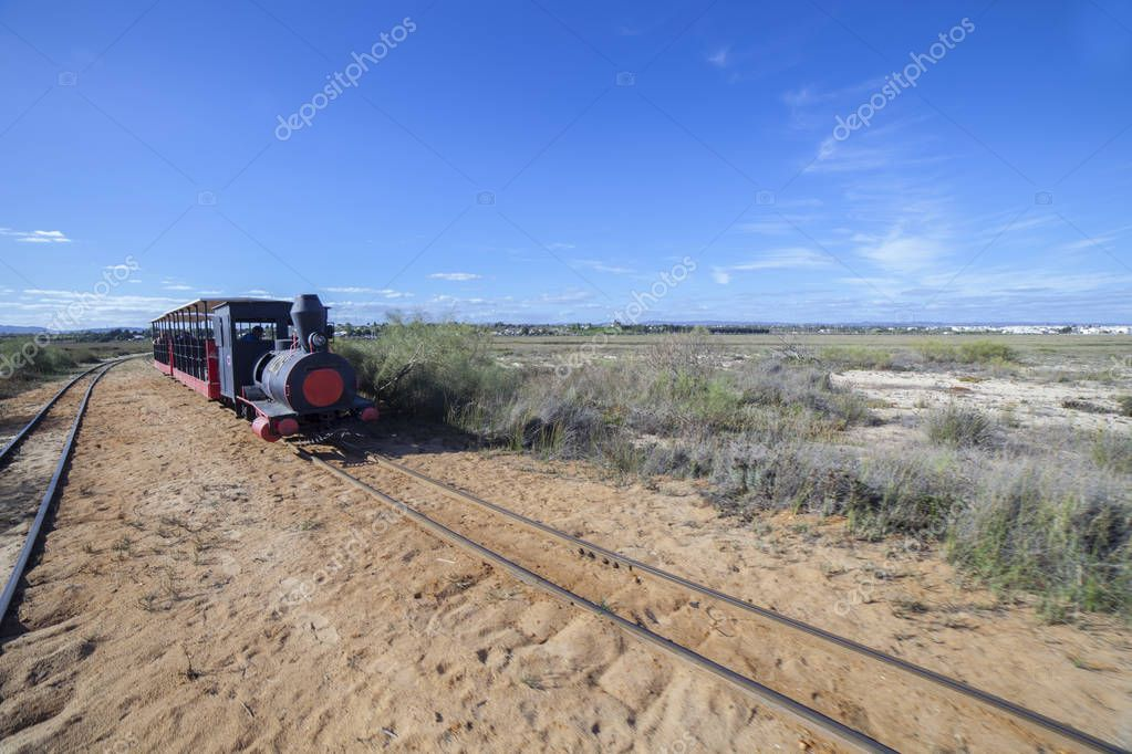 Mini-train at Barril Beach that transports visitors from the mainland to the beach, Tavira, Portugal