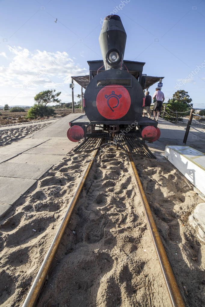Tavira, Portugal - October 14th, 2018:  Mini-train engine at Barril Beach that transports visitors from the mainland to the beach, Tavira, Portugal