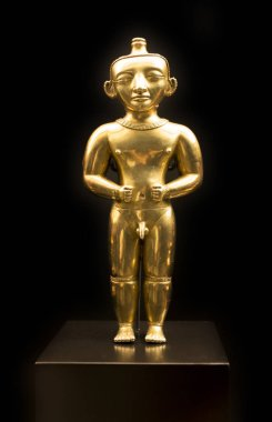 Madrid, Spain - Sept 8th, 2018: Male cacique standing  statuette of Gold Quimbayas Treasure, Museum of the Americas, Madrid, Spain
