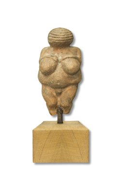 Replica of Venus of Willendorf, Old Stone Age famous sculpture. Isolated over white
