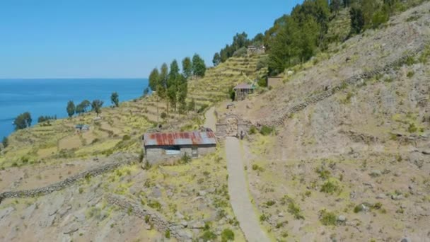 Traditional old houses of local people living in Taquile Island, Titicaca Lake, Peru