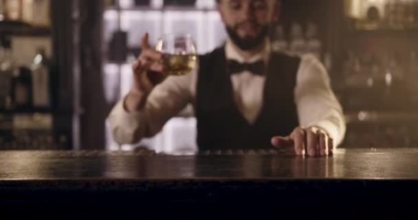 Close-up shooting. The bartender is making a presentation of alcoholic drink for the client. 4k