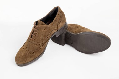 Female brown leather shoe on white background, isolated product, comfortable footwear.
