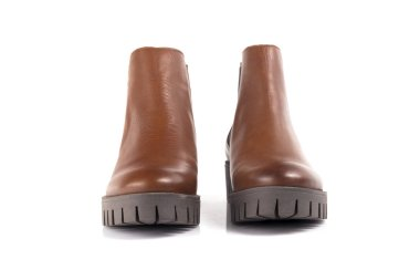 Female brown boot on white background, Isolated Product, comfortable footwear.
