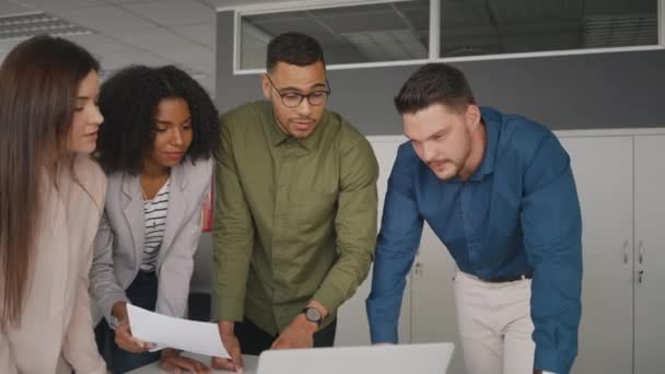 Corporate multiracial young professional businesspeople discussing business project together on laptop