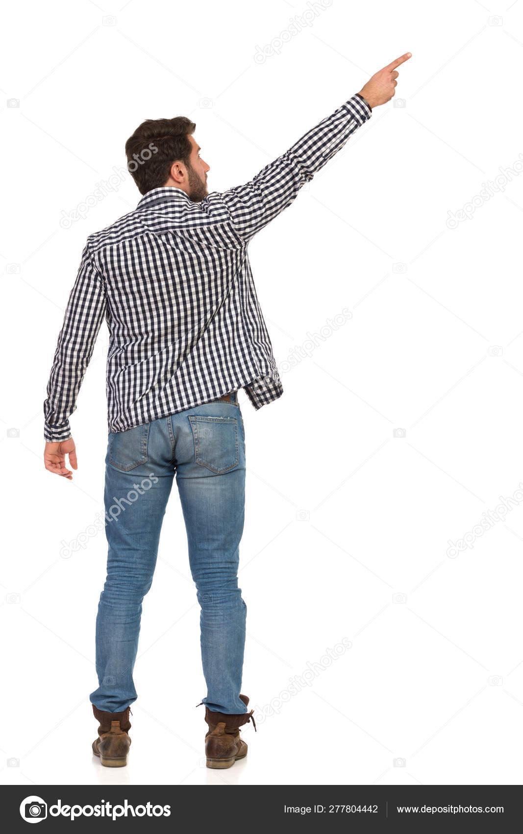 cerca genuino prezzo favorevole grandi affari sulla moda Giovane uomo con gli stivali, jeans e boscaiolo camicia sta ...