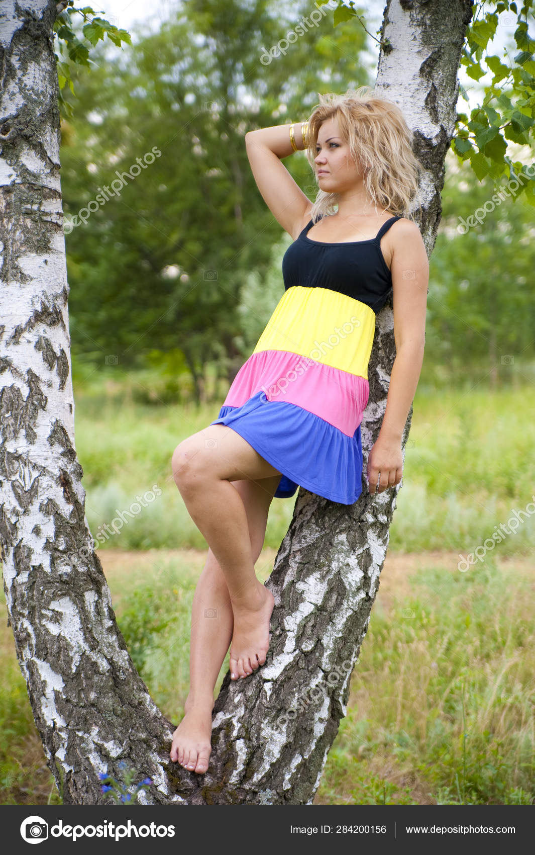 https://st4.depositphotos.com/26568676/28420/i/1600/depositphotos_284200156-stock-photo-beautiful-girl-summer-forest-nature.jpg