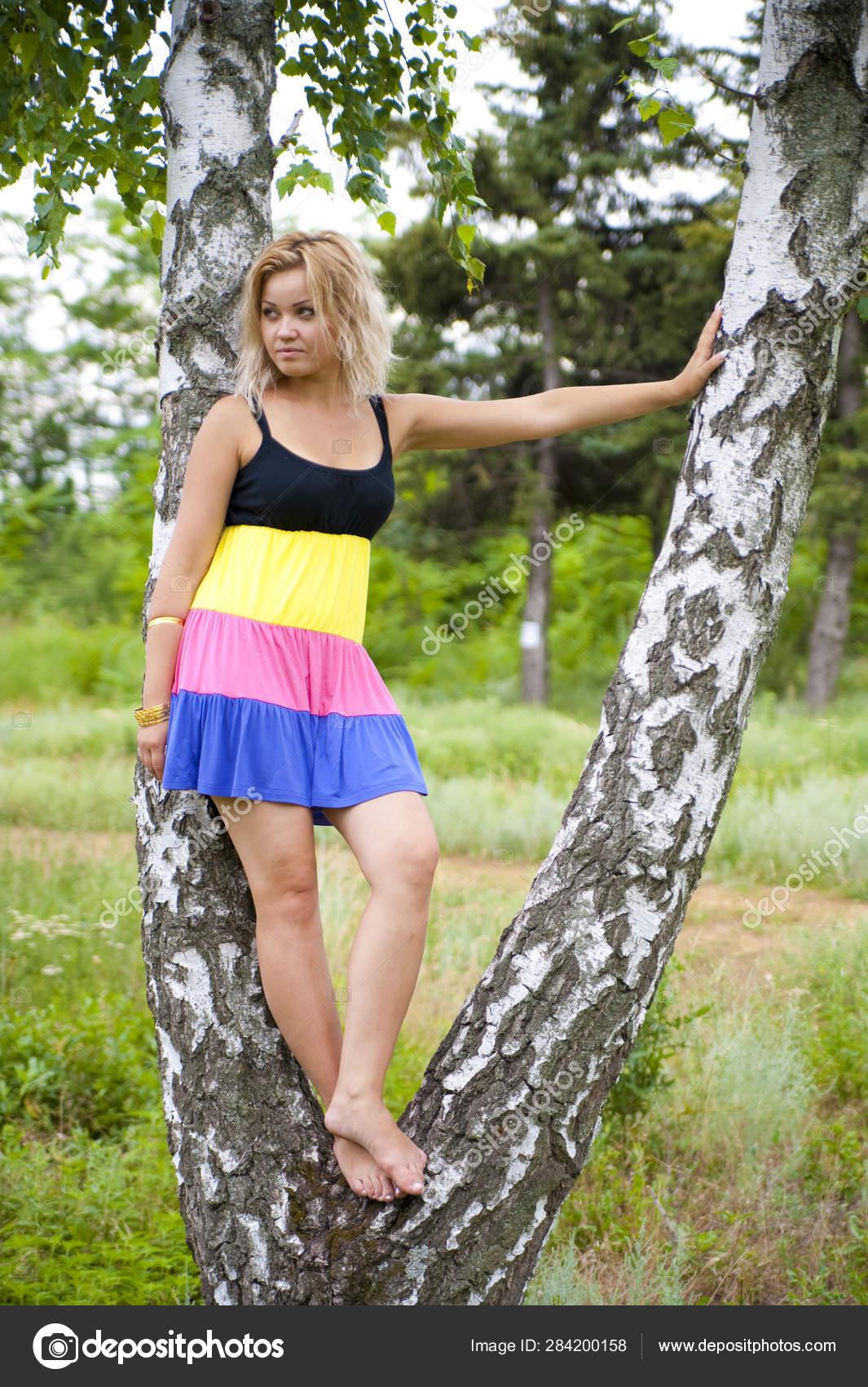 https://st4.depositphotos.com/26568676/28420/i/1600/depositphotos_284200158-stock-photo-beautiful-girl-summer-forest-nature.jpg
