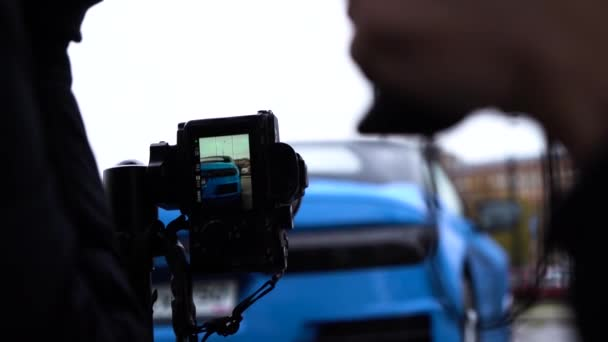 Moscow, Russia - 10 12 2019: Close up footage of camera taking photo of new russian model car roadster Crimea.