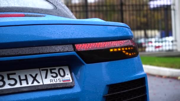 Moscow, Russia - 10 12 2019: New russian model car roadster crimea blue color on the street. Close up shot of tail light of sport car.